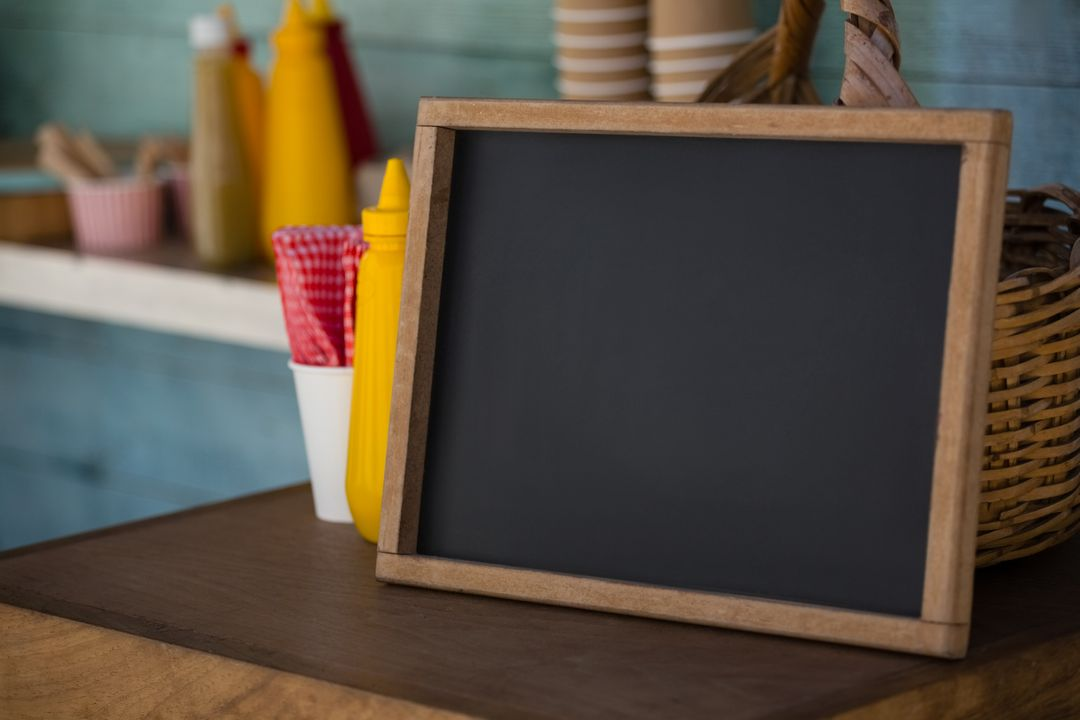 Close up of writing slate on wooden table in food truck