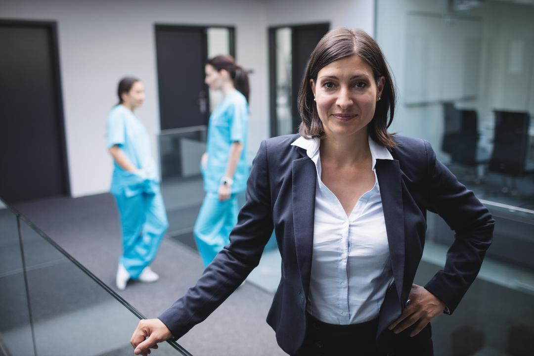 Portrait of smiling female doctor in hospital corridor Free Stock Images from PikWizard