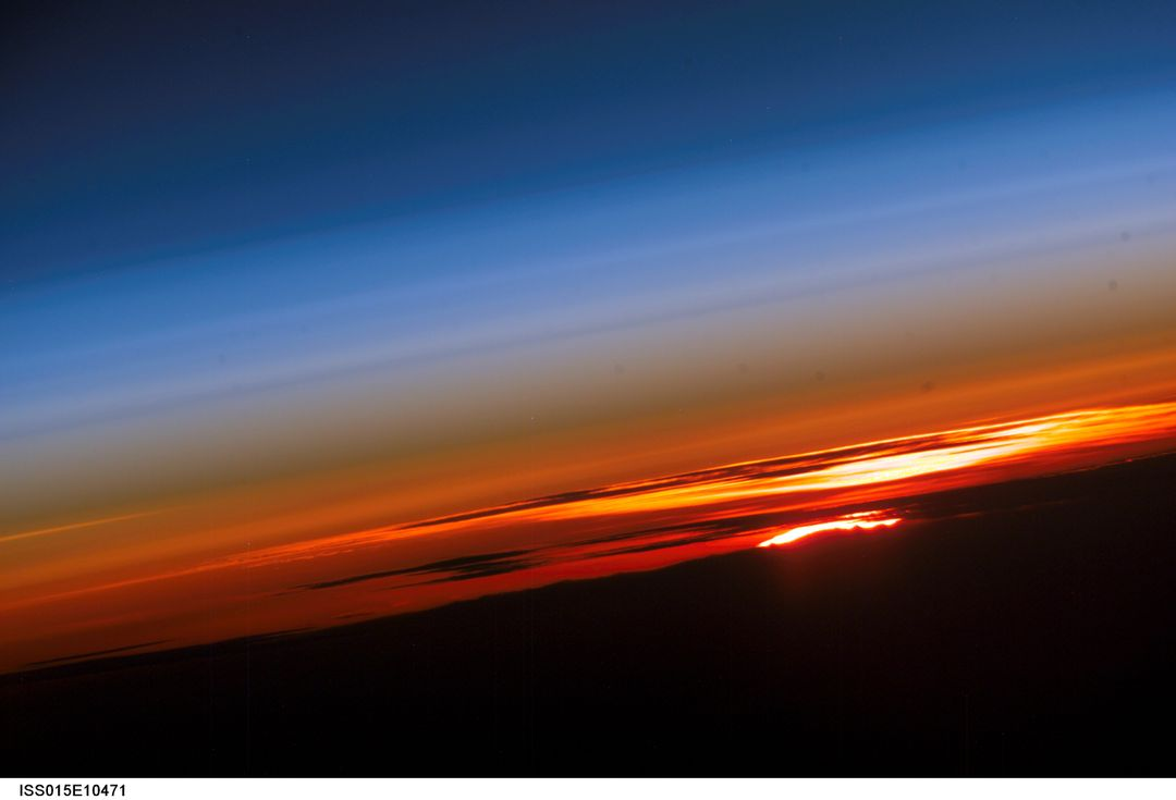 ISS015-E-10471 (3 June 2007) --- The profile of the atmosphere and a setting sun are featured in this image photographed by an Expedition 15 crewmember on the International Space Station.