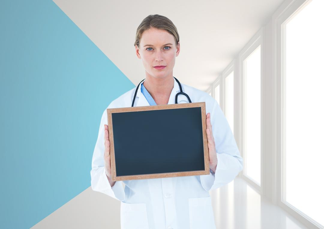 Digital composition of doctor holding a blank slateboard in hallway Free Stock Images from PikWizard