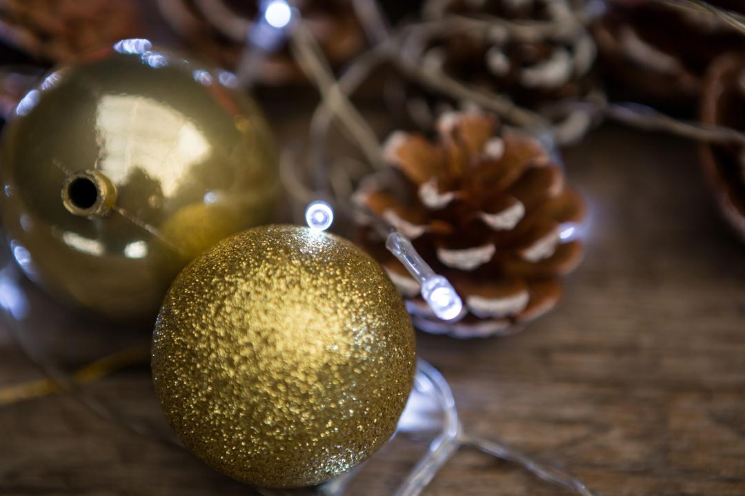 Christmas bauble ball on wooden plank during christmas time
