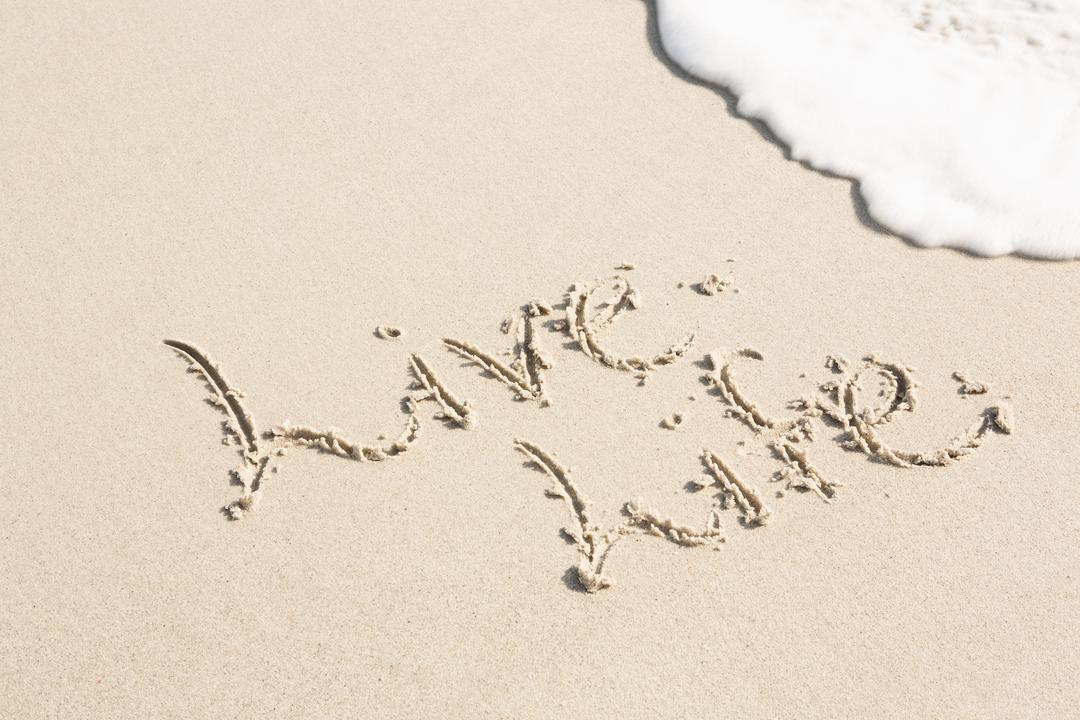 Live life written on sand at beach