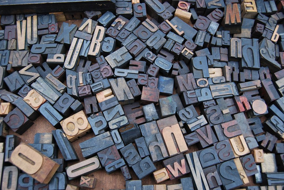 Overhead image of multi-colored blocks of letters and numbers