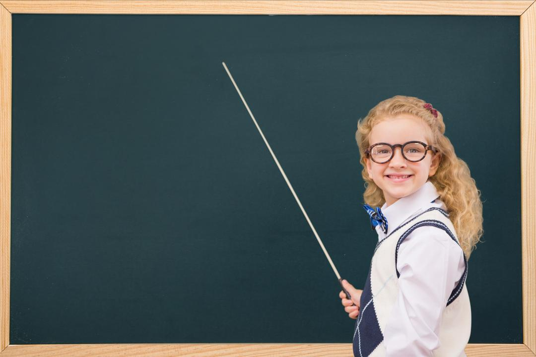 Digital composite of Side view of smiling schoolgirl with stick standing by blackboard Free Stock Images from PikWizard