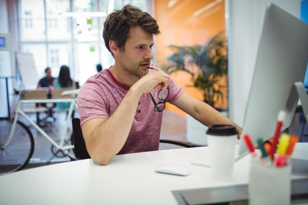 Image of a Man Working on a Computer