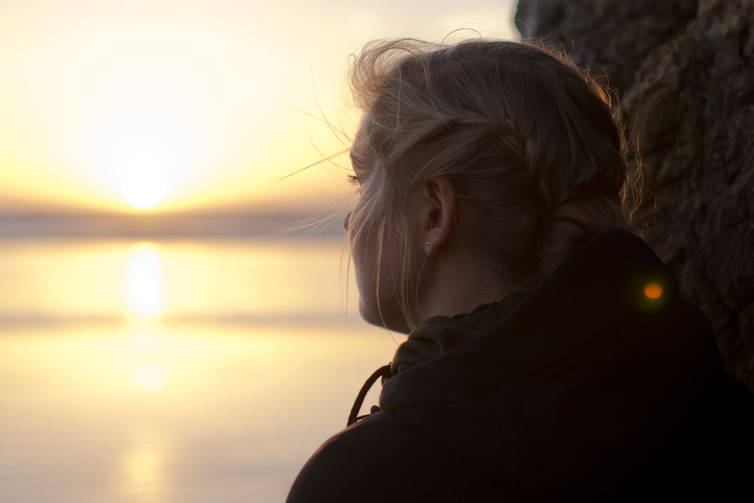 Image of a Woman Looking into the Distance at Sunset