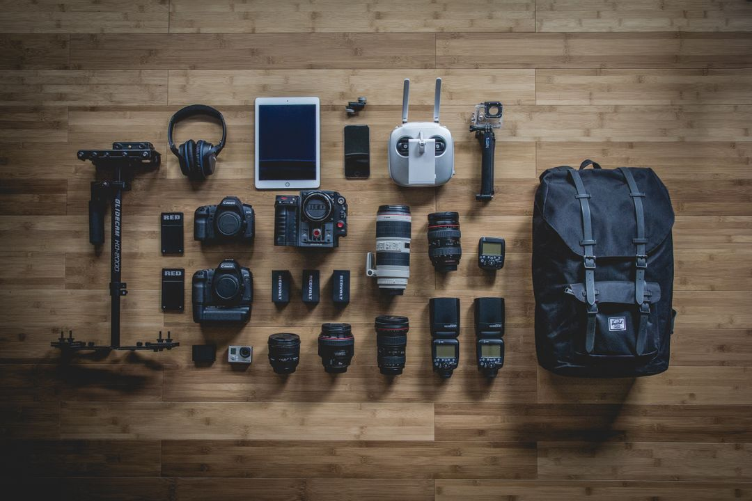 Overhead image of a selection of cameras and photography equipment, comparing the technology