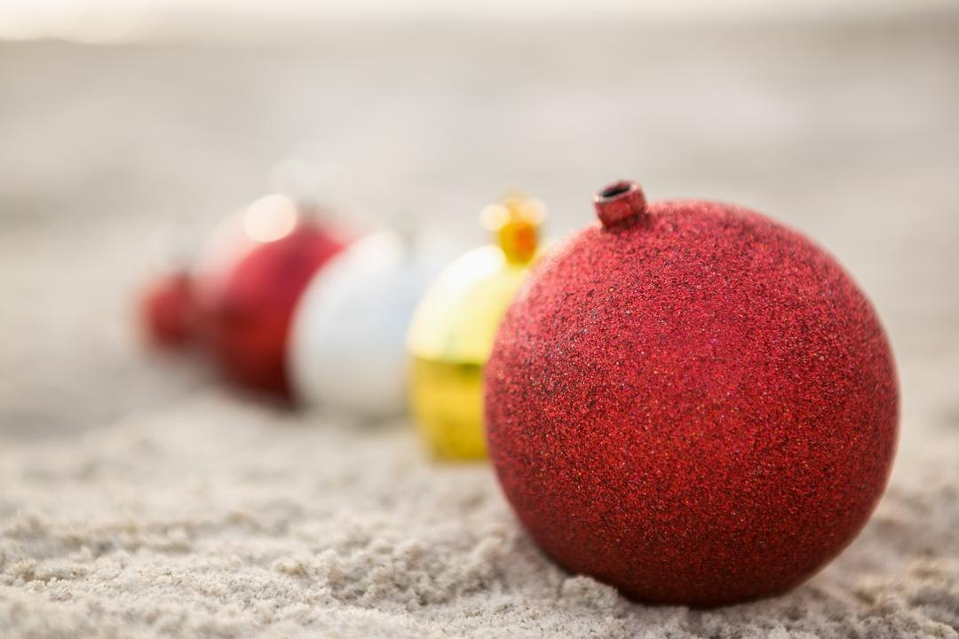 Christmas baubles arranged on the sand at beach Free Stock Images from PikWizard