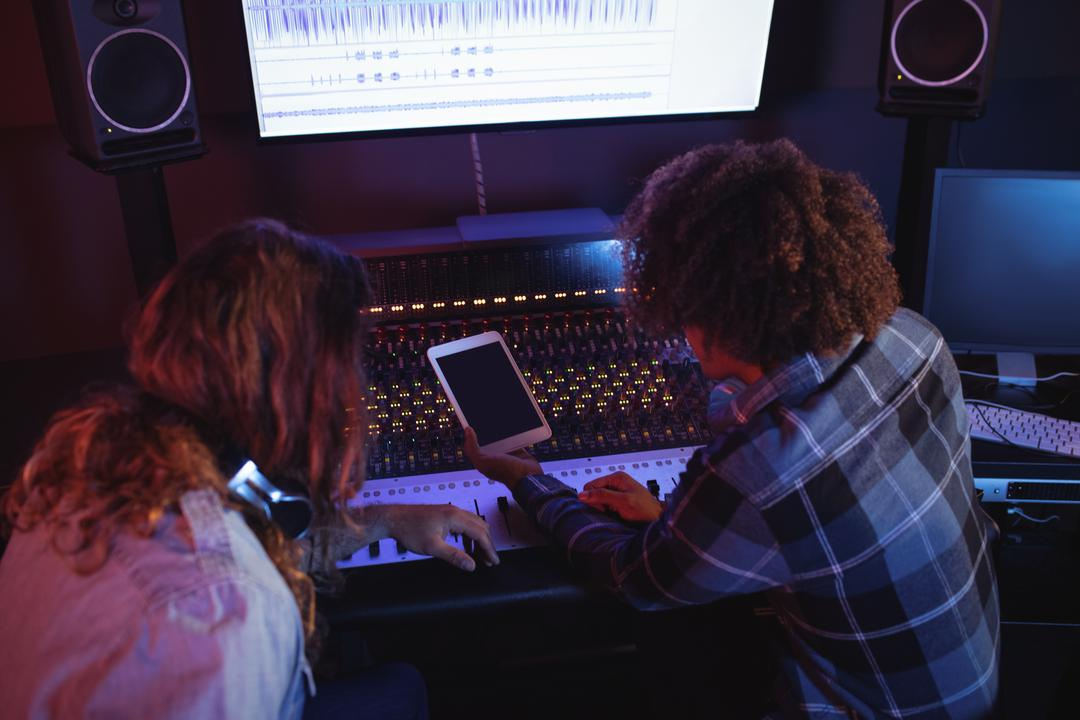 Male audio engineers using digital tablet in recording studio Free Stock Images from PikWizard