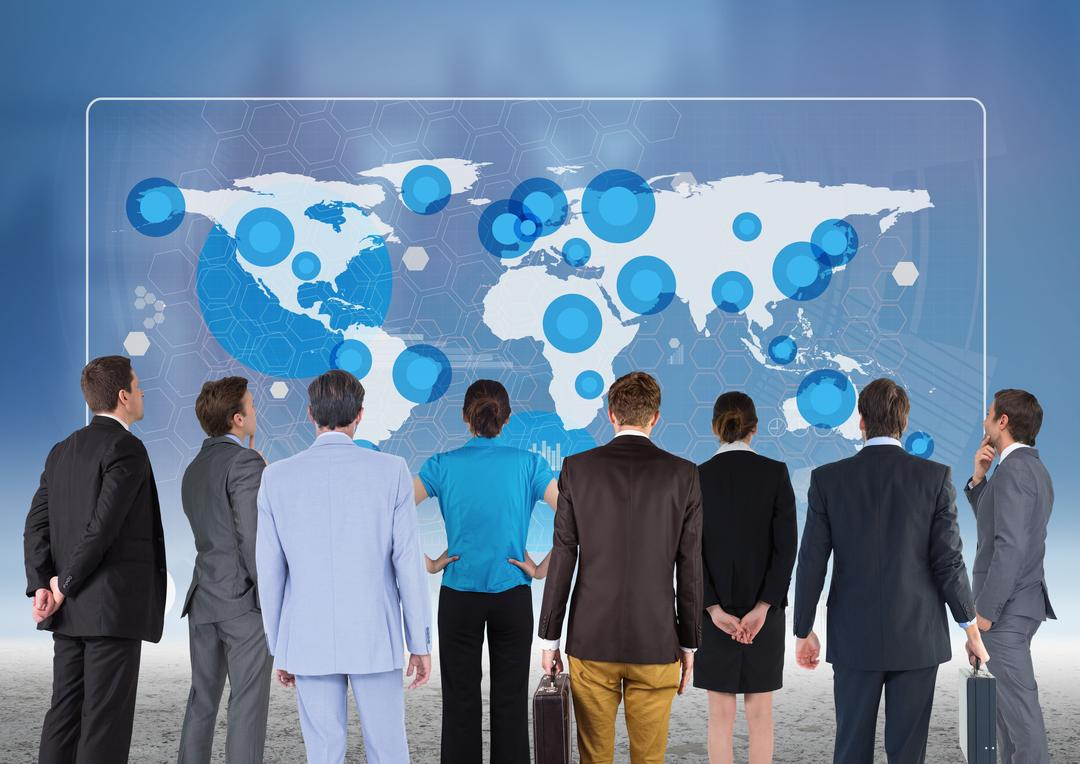 Digital composition of team of business executives looking at world map