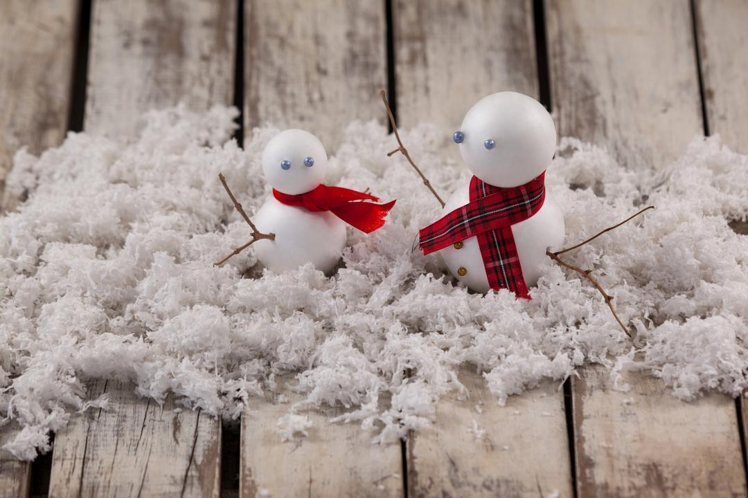 Close-up of two snowman with fake snow Free Stock Images from PikWizard