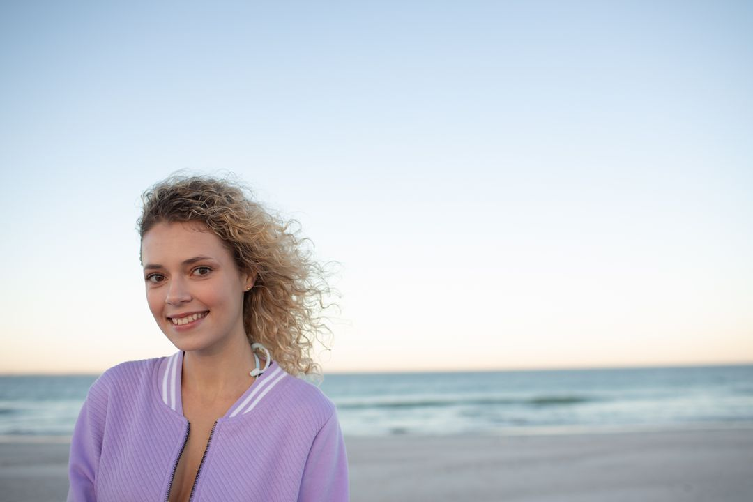 Portrait of beautiful woman standing on the beach