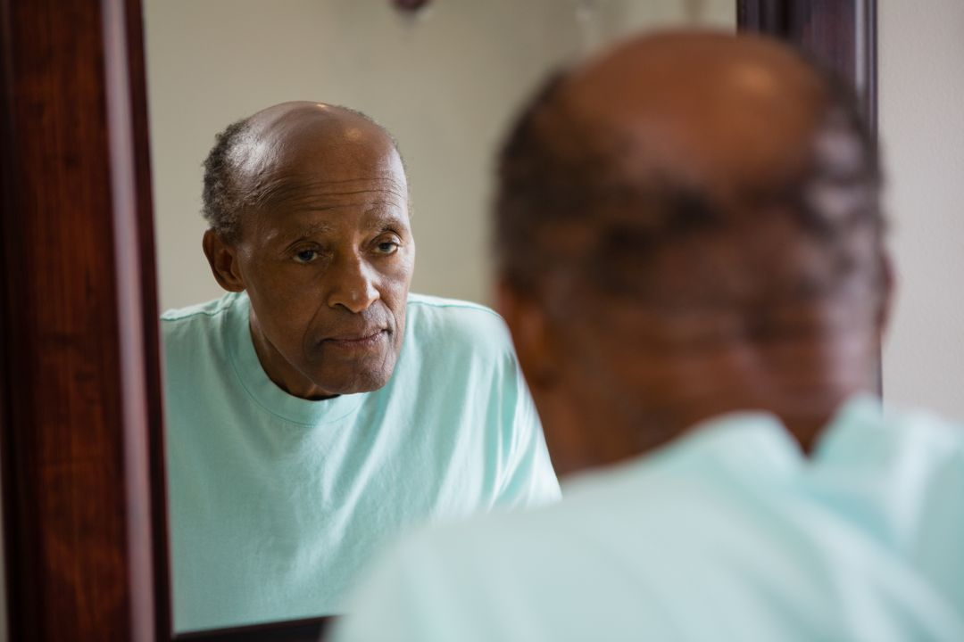 Mirror with reflection of concerned senior man in bathroom Free Stock Images from PikWizard