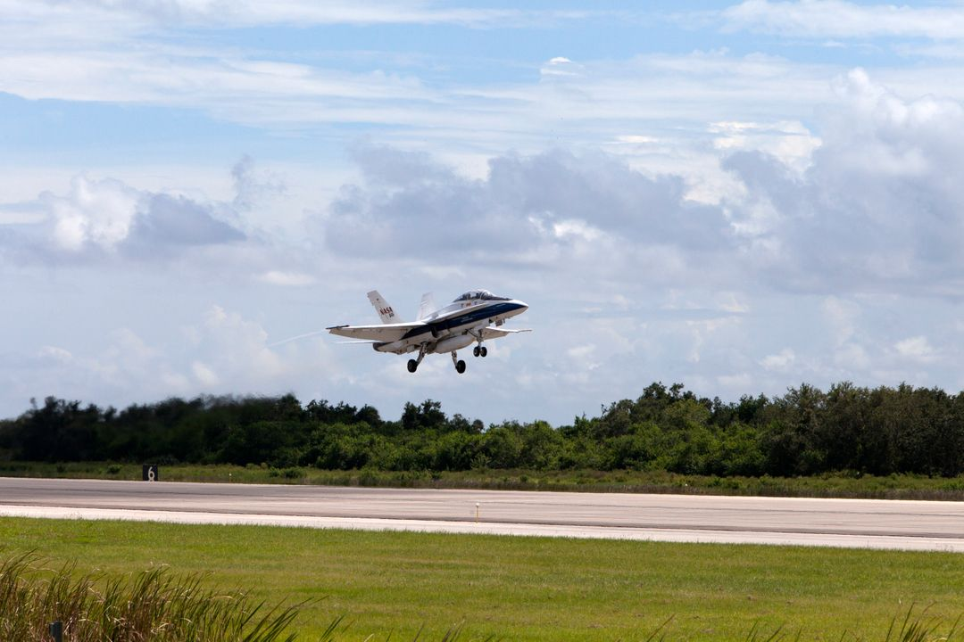 A NASA F-18 jet takes off from the agency's Shuttle Landing Facility at NASA's Kennedy Space Center in Florida. Several flights a day have been taking place the week of Aug. 21, 2017 to measure the effects of sonic booms. It is part of NASA's Sonic Booms in Atmospheric Turbulence, or SonicBAT II Program. NASA at Kennedy is partnering with the agency's Armstrong Flight Research Center in California, Langley Research Center in Virginia, and Space Florida for a program in which F-18 jets will take off from the Shuttle Landing Facility and fly at supersonic speeds while agency researchers measure the effects of low-altitude turbulence caused by sonic booms.