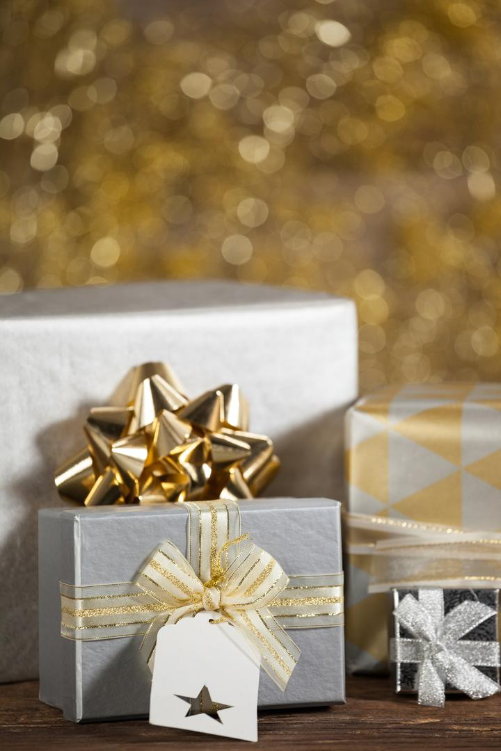 Close-up of various wrapped gift box on wooden table during christmas time