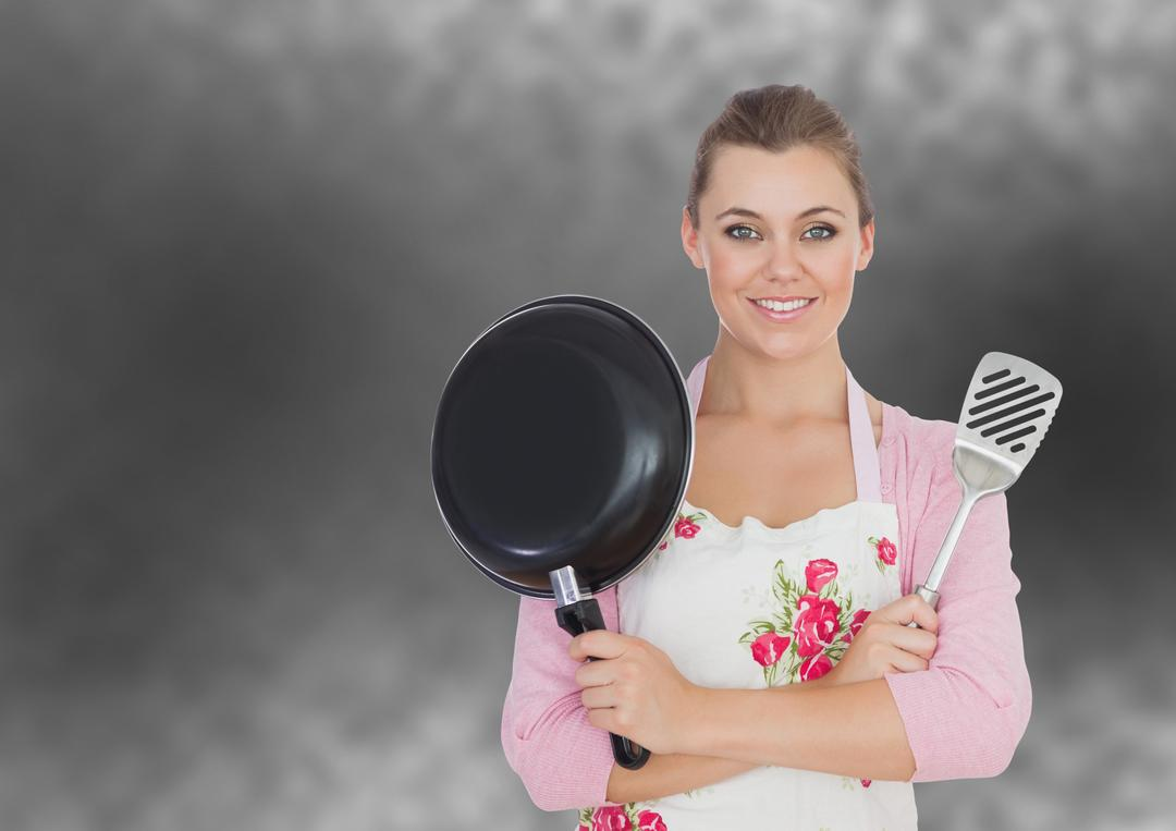 Digital composite of cook woman with fridge pan and skimmer on dark background