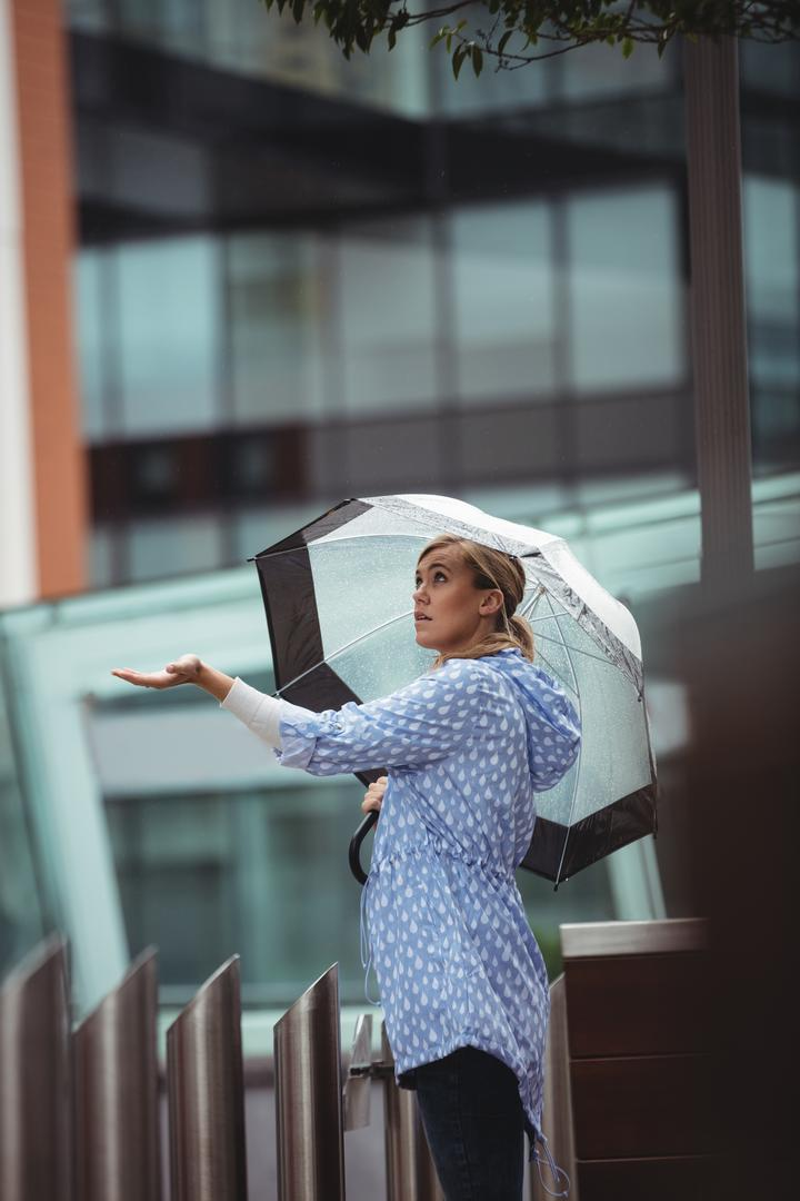 Beautiful woman enjoying rain during rainy season