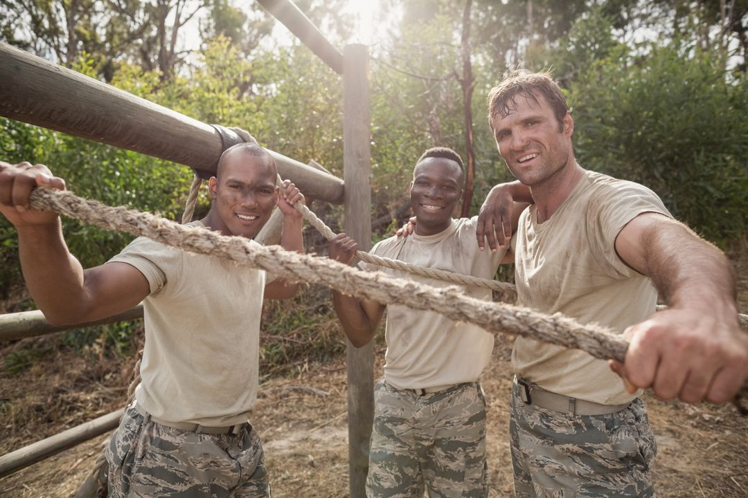 Portrait of military soldiers smiling during obstacle training at boot camp Free Stock Images from PikWizard