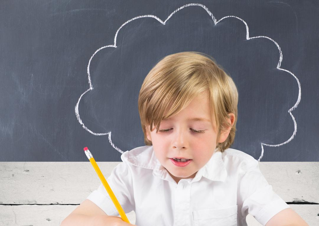 Attentive schoolboy doing homework against blackboard Free Stock Images from PikWizard