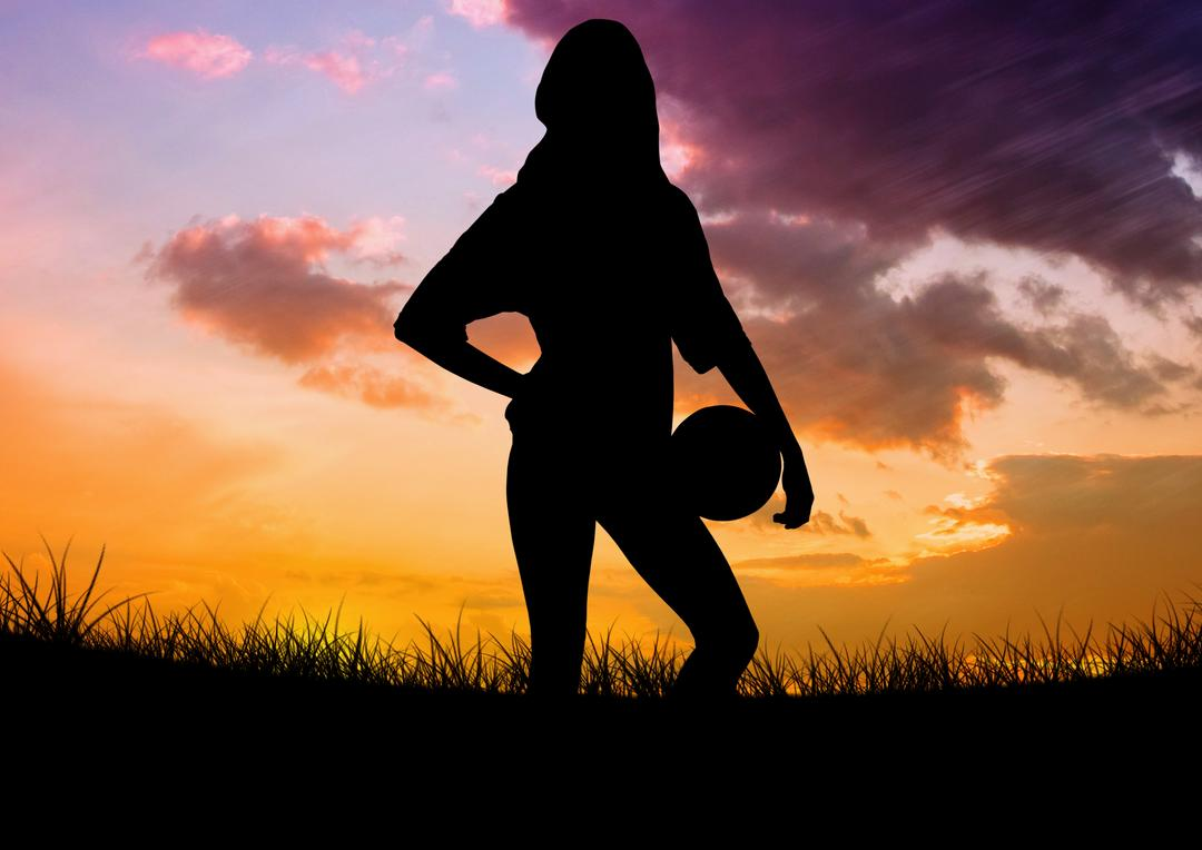 Digital composition of woman silhouette holding ball on meadow against sky background