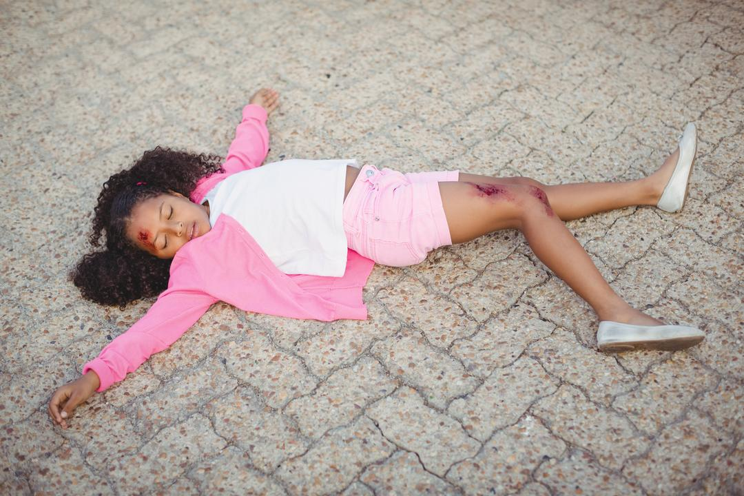 Close-up of unconscious girl fallen on ground after accident Free Stock Images from PikWizard