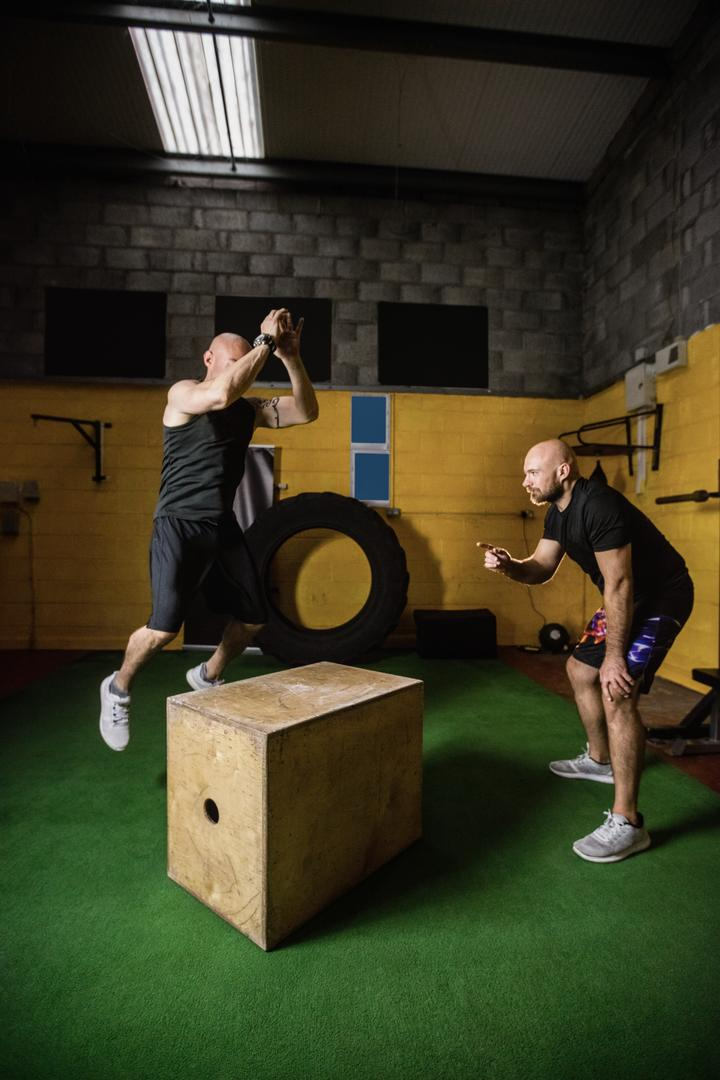 Thai boxers practicing on wooden box in the fitness studio