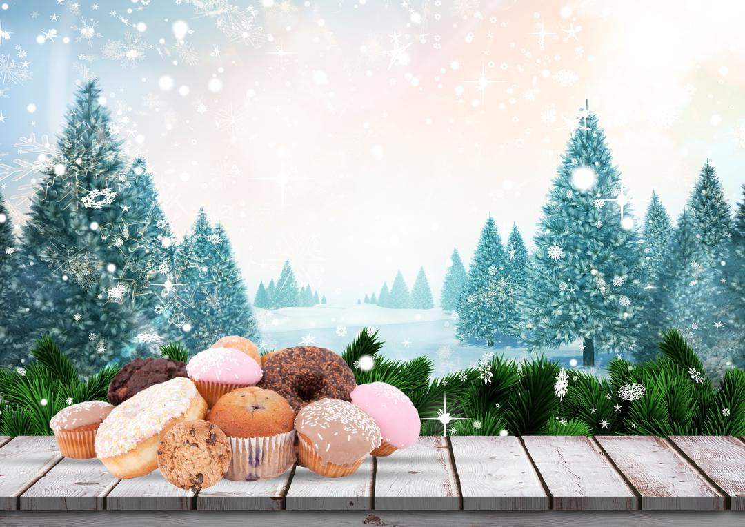 Digital composition of various cupcakes on wooden table with pine trees and snowflakes in background