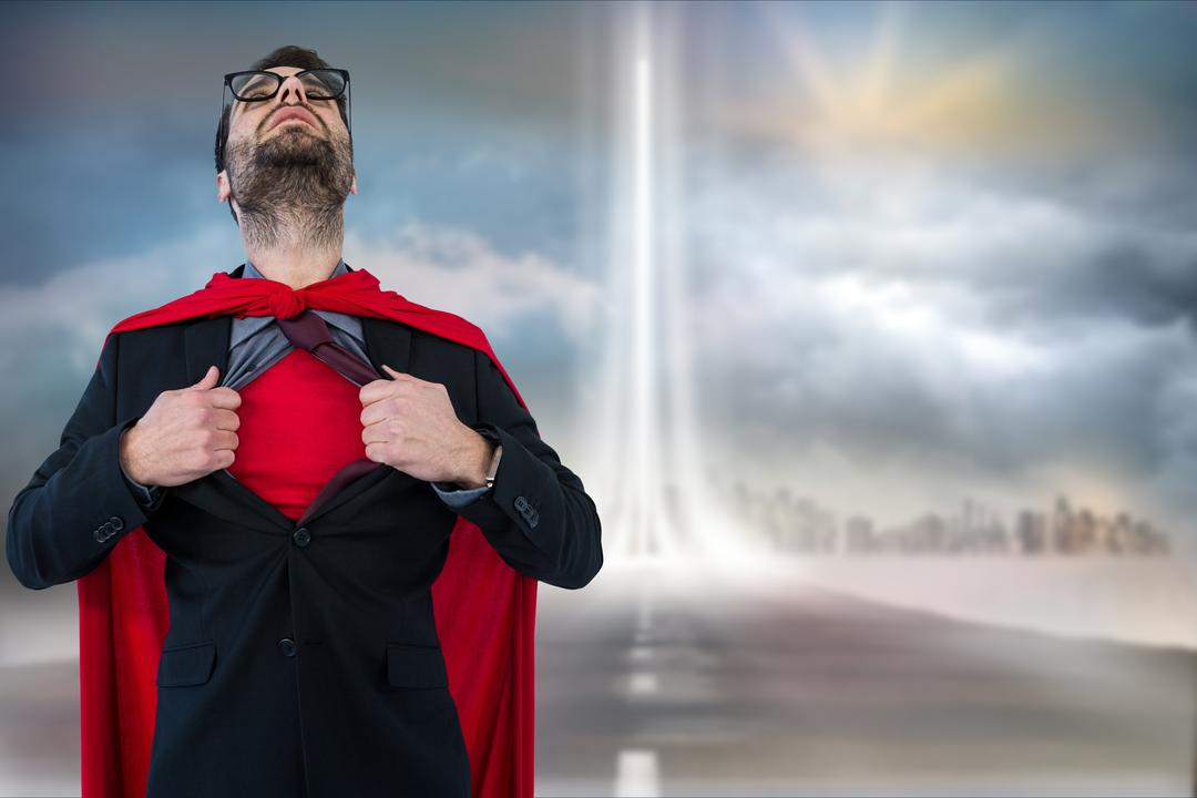 Digital composite of Businessman in super hero costume tearing shirt against cloudy sky Free Stock Images from PikWizard