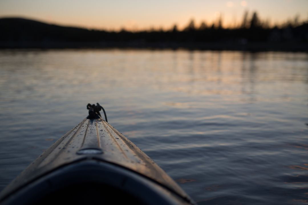 Brown Kayak in a Body of Water