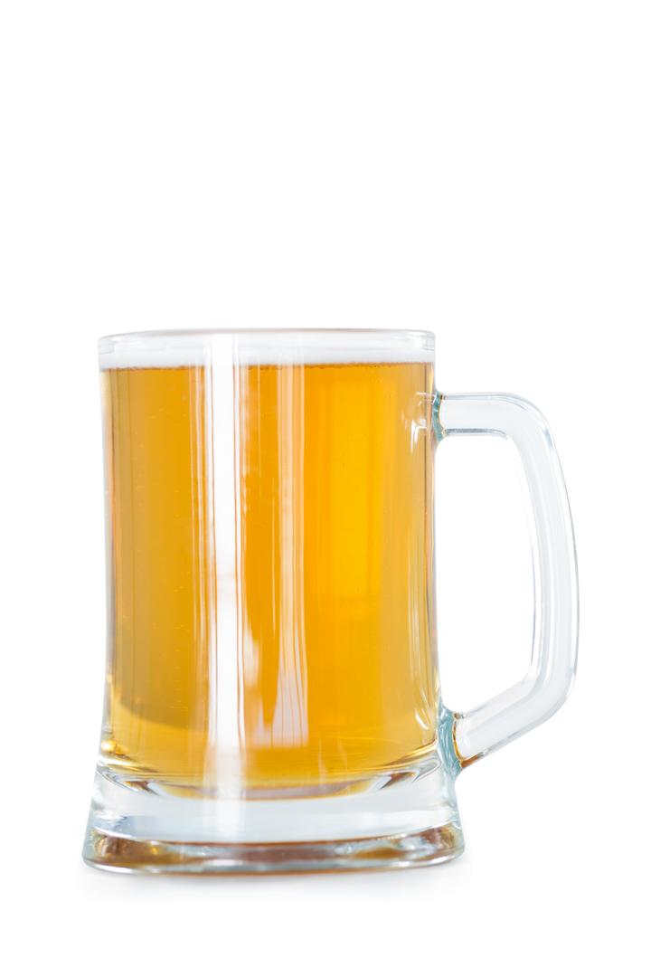 Close-up of beer mug on white background