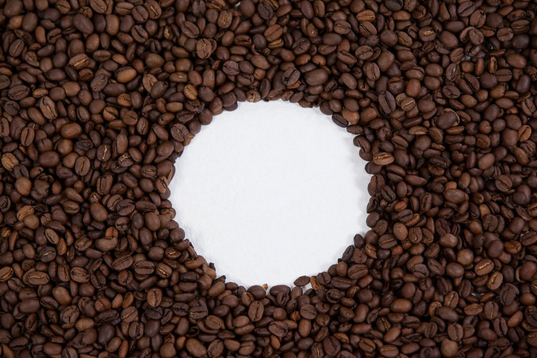 Coffee beans forming circle shape on white background Free Stock Images from PikWizard