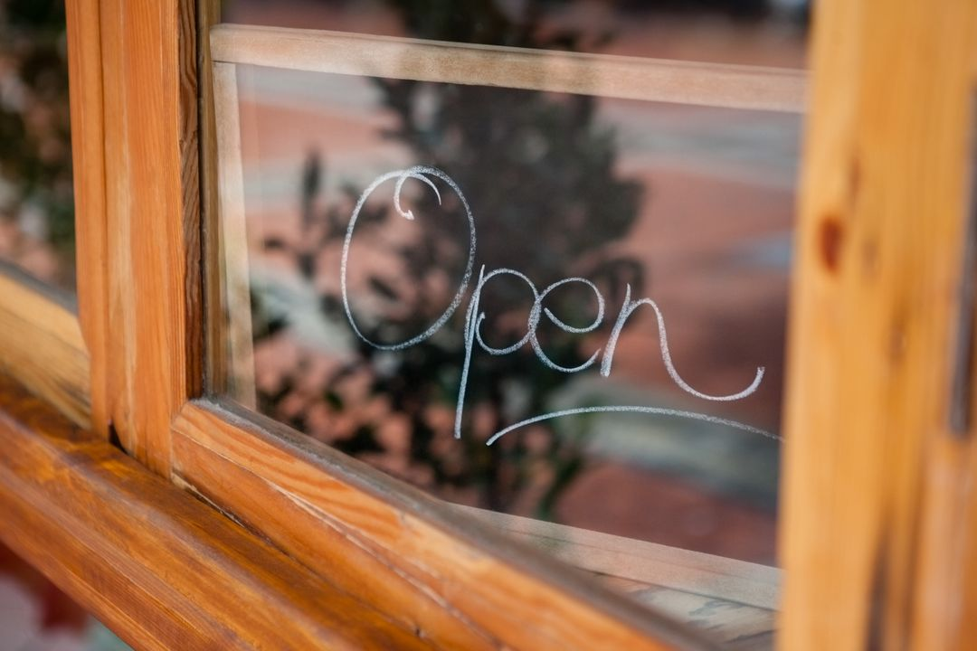 Close up of open text on glass window of coffee shop Free Stock Images from PikWizard