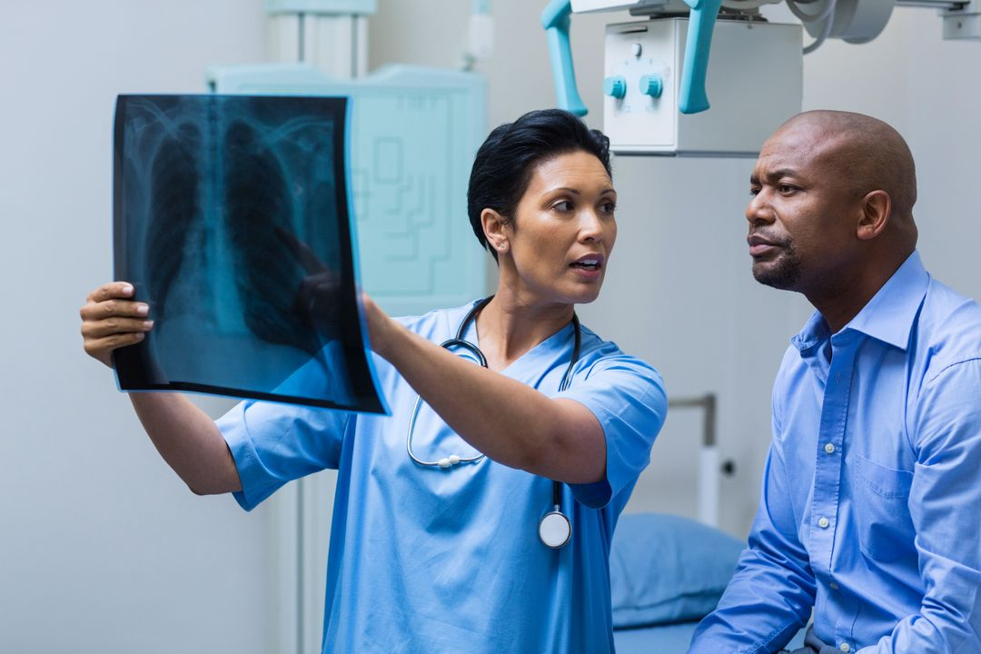 Nurse discussing x-ray with patient in hospital