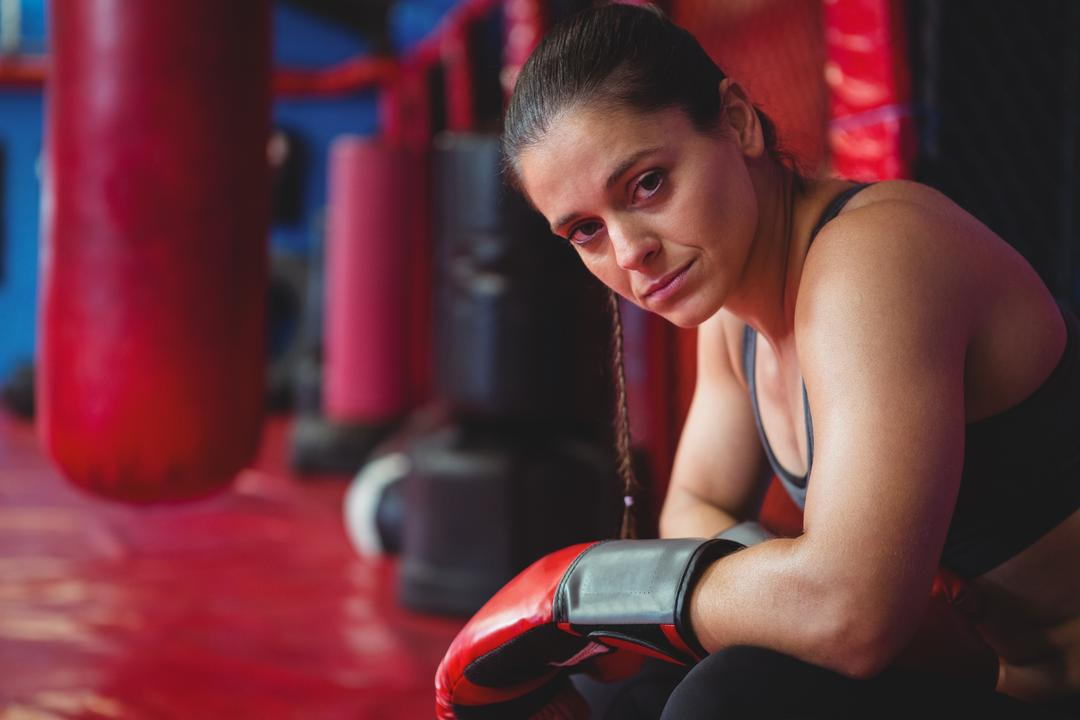 Portrait of female boxer in fitness studio