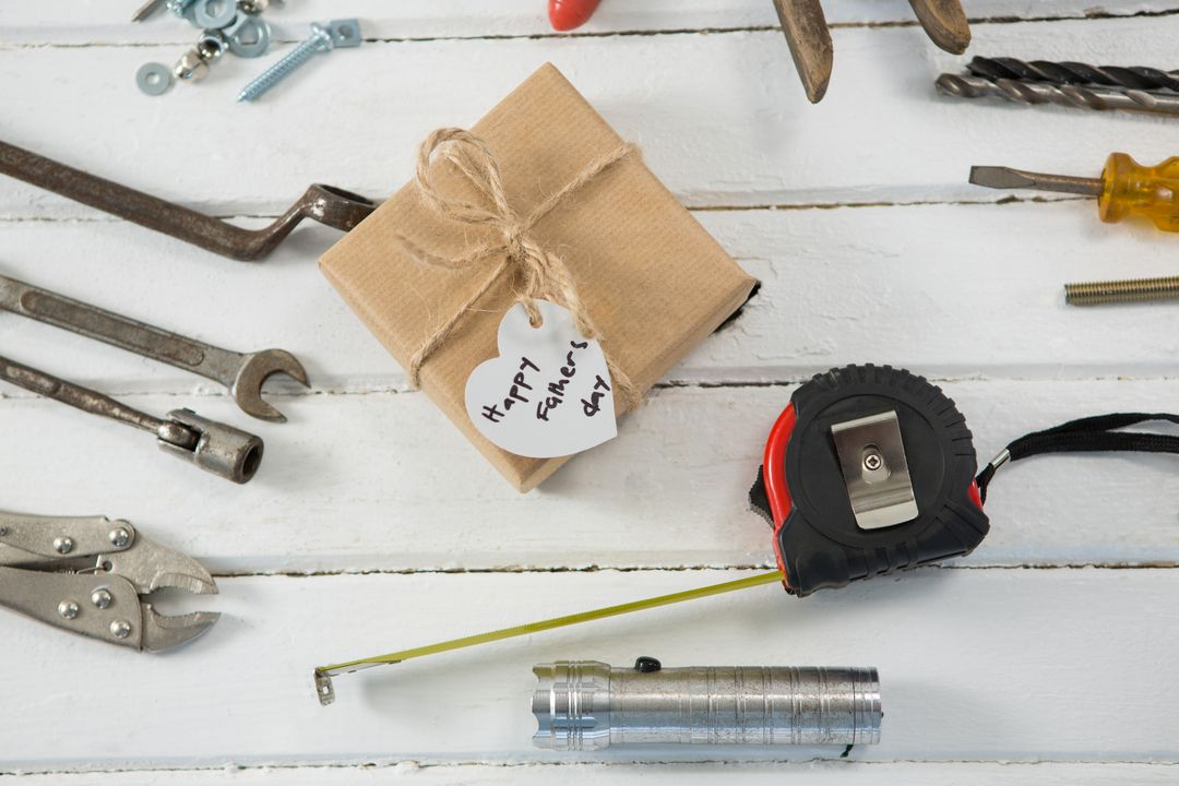 Overhead view of fathers day gift with tools on wooden table Free Stock Images from PikWizard