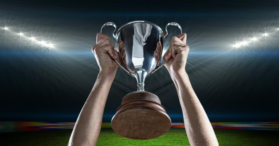 Digital composite image of athlete hands holding trophy