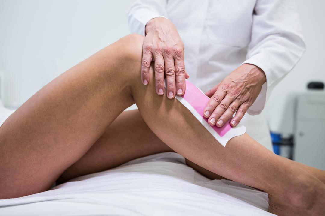 Woman getting her leg hair removed at beauty salon Free Stock Images from PikWizard