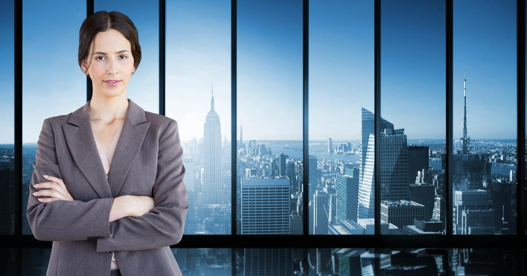 Digital composite image of businesswoman standing with arms crossed