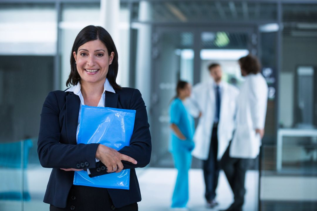 Portrait of a confident businesswoman holding a file in hospital premises Free Stock Images from PikWizard