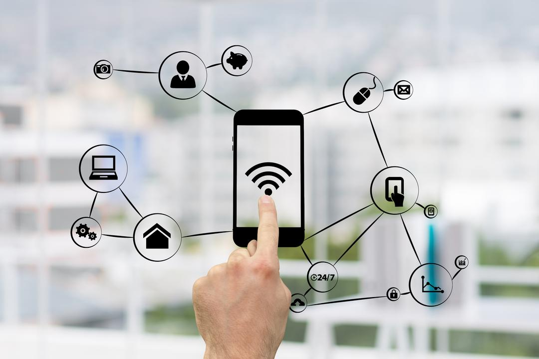 hand pointing on a graphic of a phone surrounded by technology and business graphics