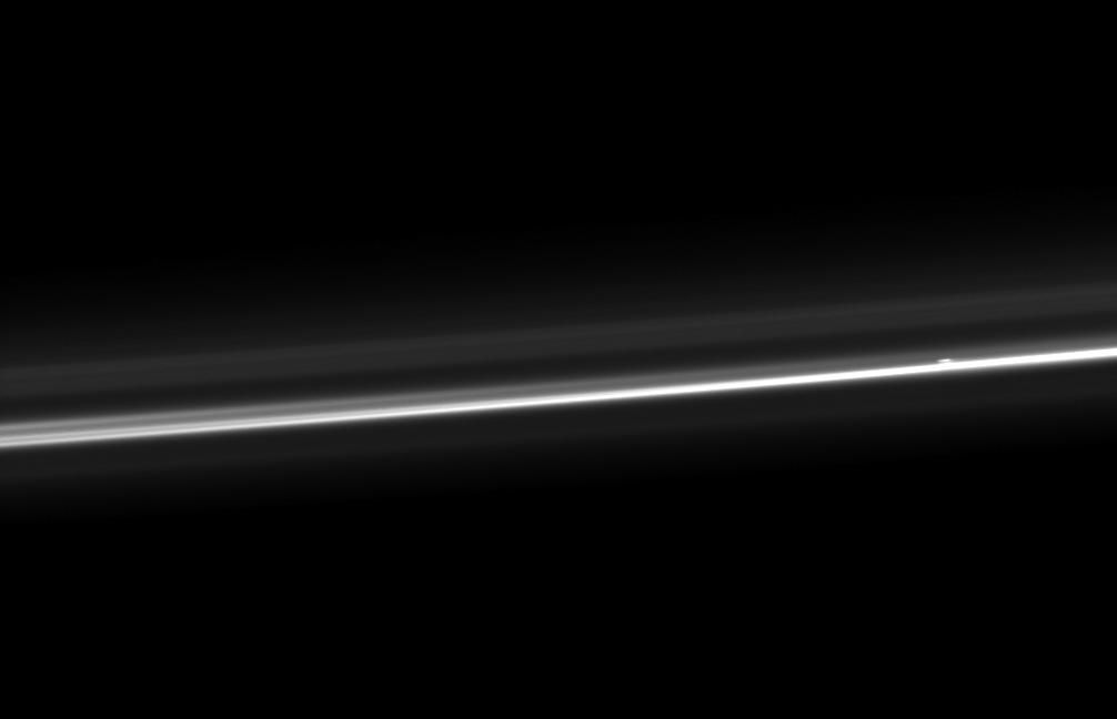 NASA Cassini spacecraft captures Saturn ever-changing F ring, showing its bright core, another strand of ring material, and a breakaway clump of material close to the core.
