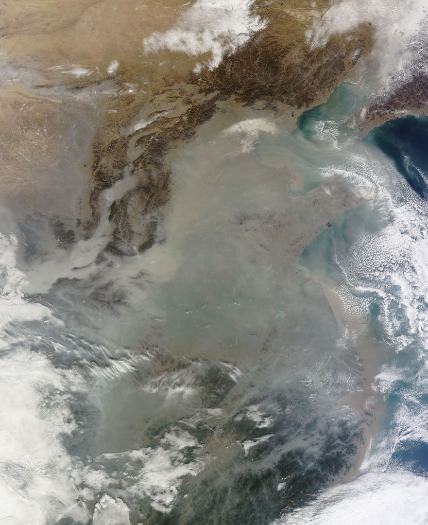"The skies over northern China were shrouded with a thick haze in late December, 2013. The Moderate Resolution Imaging Spectroradiometer (MODIS) aboard the Terra satellite captured this true-color image on December 23.  The dense, gray haze obscures almost all the land and much of the coastal waters from view south and east of the Taihang Mountains. Clearer air covers the region north of the mountains, although fingers of haze roll through most river valleys. The cities of Beijing and Hebei, both west of the Bohai Sea are complete enshrouded.  By December 24 the smog levels in some area exceeded World Health Organization-recommended levels by 30 times, according to Bloomberg News. The concentration of PM2.5, which are fine air particulates, were reported at 421 micrograms per cubic meter at 2 p.m. near Tiananmen Square in Beijing, while levels were 795 in Xi'an and 740 in Zhengzhou. The World Health Organization (WHO) recommends 24-hour exposure to PM2.5 concentrations no higher than 25 micrograms per cubic meter.  While not the sole cause of haze and pollution, the use of coal as a very cheap energy source adds to the problem, particularly north of the Huai River. Prior to 1980, the government policy provided free coal for fuel boilers for all people living north of the Huai River. The widespread use of coal allows people in the north to stay warm in winter, but they have paid a price in air quality.  According to Michael Greenstone, a Professor of Environmental Economics at Massachusetts Institute of Technology (MIT), whose research team published a paper on sustained exposure to air pollution on life expectancy in the region, air pollution, as measured by total suspended particulates, was about 55% higher north of the Huai River than south of it, for a difference of around 184 micrograms of particulate matter per cubic meter. The research, published in Proceedings of the National Academy of Sciences in July, 2013, also noted life expectancies were about 5.5 years lower in the north, owing to an increased incidence of cardiorespiratory mortality.  Air pollution is an on-going issue for the government of China, and Beijing's Five-Year Clean Air Action Plan aims to reduce overall particle density by over 25 percent on the PM2.5 scale by 2017, and also takes aim at shutting down all coal-burning plants.  Credit: NASA/GSFC/Jeff Schmaltz/MODIS Land Rapid Response Team   <b><a href=""http://www.nasa.gov/audience/formedia/features/MP_Photo_Guidelines.html"" rel=""nofollow"">NASA image use policy.</a></b>  <b><a href=""http://www.nasa.gov/centers/goddard/home/index.html"" rel=""nofollow"">NASA Goddard Space Flight Center</a></b> enables NASA's mission through four scientific endeavors: Earth Science, Heliophysics, Solar System Exploration, and Astrophysics. Goddard plays a leading role in NASA's accomplishments by contributing compelling scientific knowledge to advance the Agency's mission.  <b>Follow us on <a href=""http://twitter.com/NASA_GoddardPix"" rel=""nofollow"">Twitter</a></b>  <b>Like us on <a href=""http://www.facebook.com/pages/Greenbelt-MD/NASA-Goddard/395013845897?ref=tsd"" rel=""nofollow"">Facebook</a></b>  <b>Find us on <a href=""http://instagram.com/nasagoddard?vm=grid"" rel=""nofollow"">Instagram</a></b>"