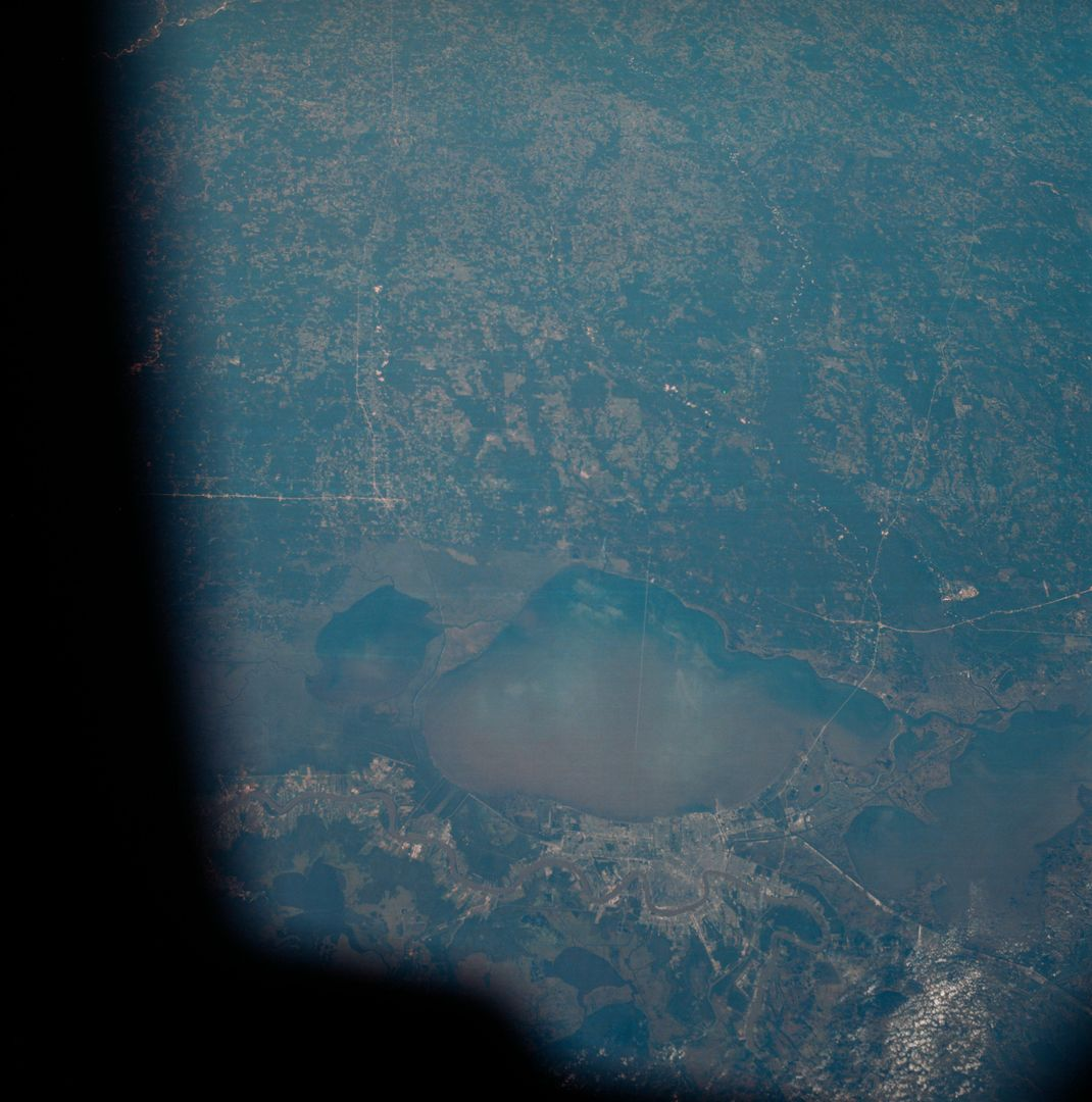 The greater New Orleans area, including portions of Louisiana and Mississippi, as seen from the Apollo 7 spacecraft during its 120th revolution of the earth. Photographed from an altitude of 95 nautical miles, at ground elapsed time of 190 hours and 45 minutes. The largest body of water in the picture is Lake Pontchartrain. The Mississippi River is clearly visible as it meanders past New Orleans. Note highway network, and 25-mile causeway across lake. Free Stock Images from PikWizard