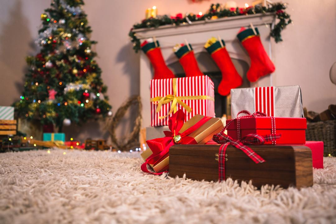 Image of a Christmas Tree with Presents Near the Fireplace