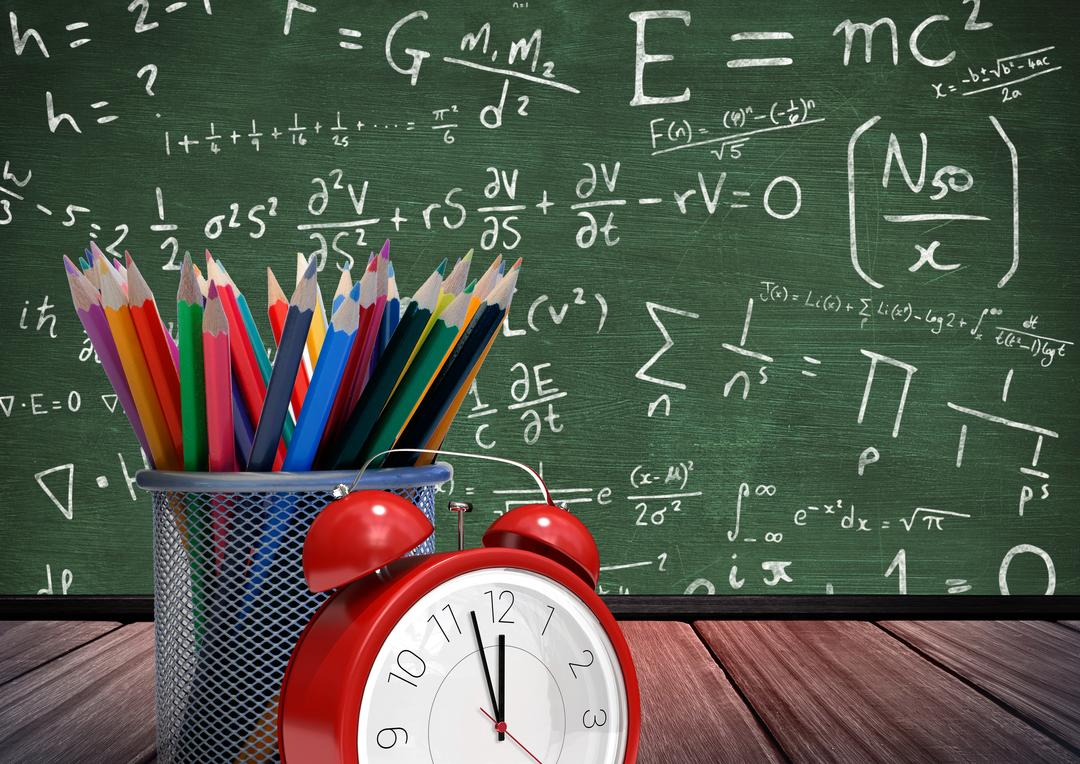 Digital composition of alarm clock with colorful pencils on wooden board against formula background Free Stock Images from PikWizard