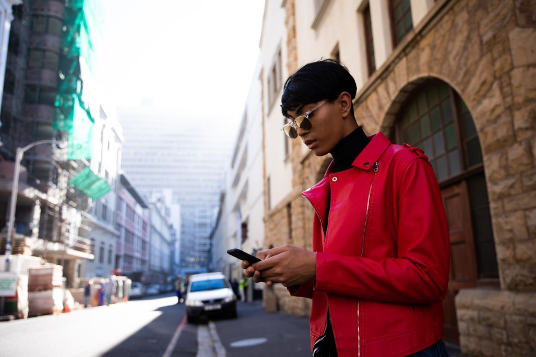 Image of a Person Being on his Smartphone While Crossing the Street