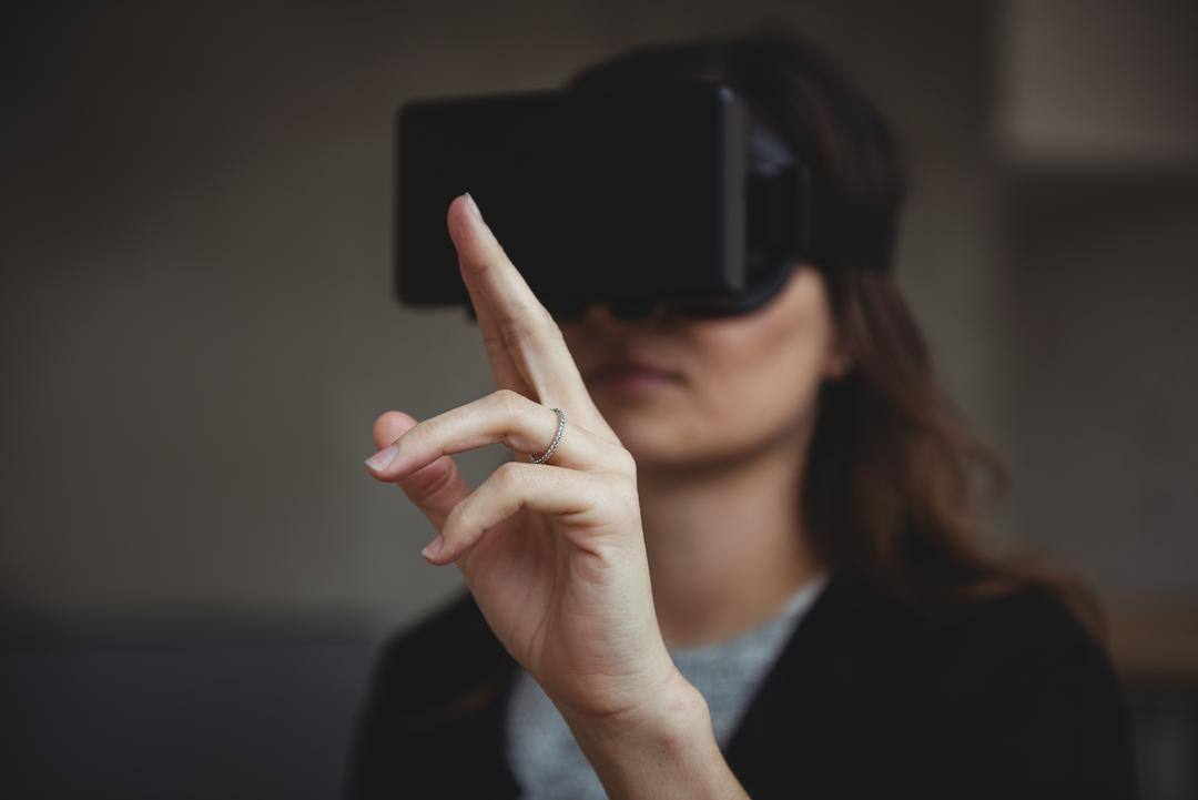 Female business executive using virtual reality headset in office Free Stock Images from PikWizard