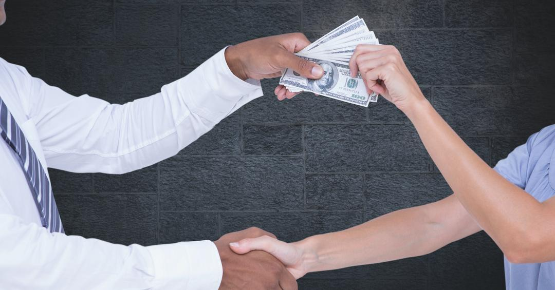 Digital composite of Cropped image of business people's hands holding money representing corruption concept Free Stock Images from PikWizard