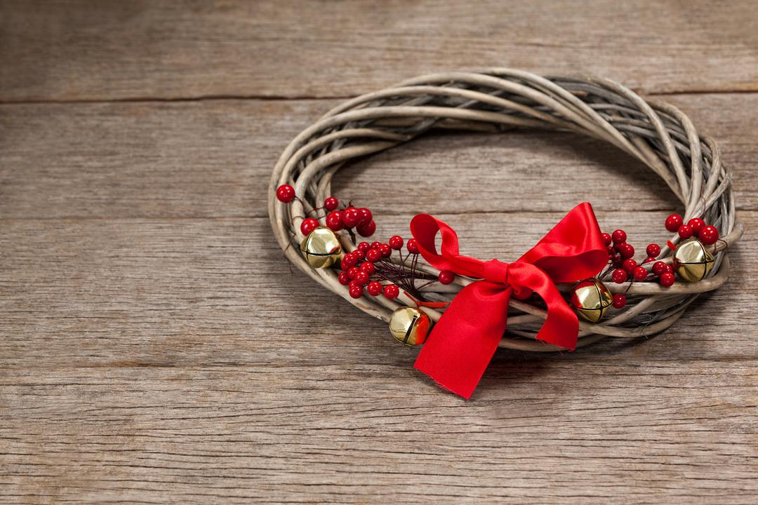 Grapevine wreath with red ribbon on a plank Free Stock Images from PikWizard