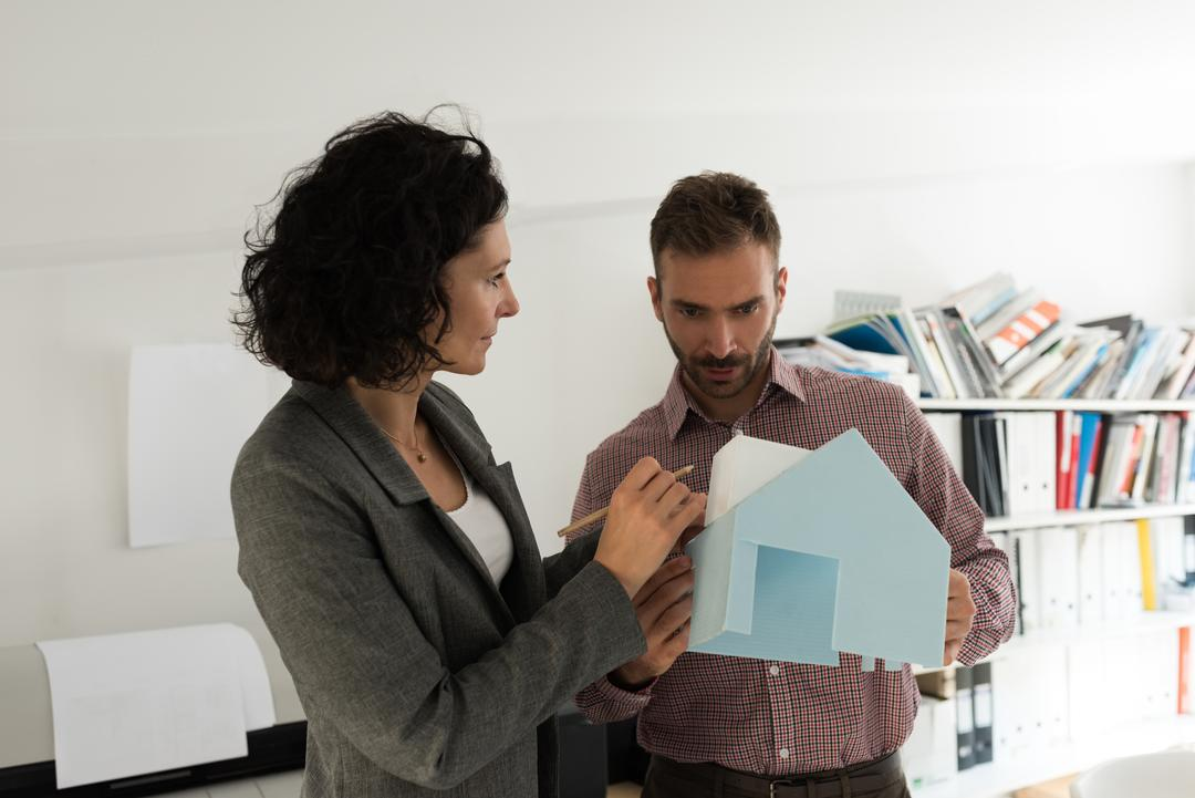 Male and female architects working together in the office